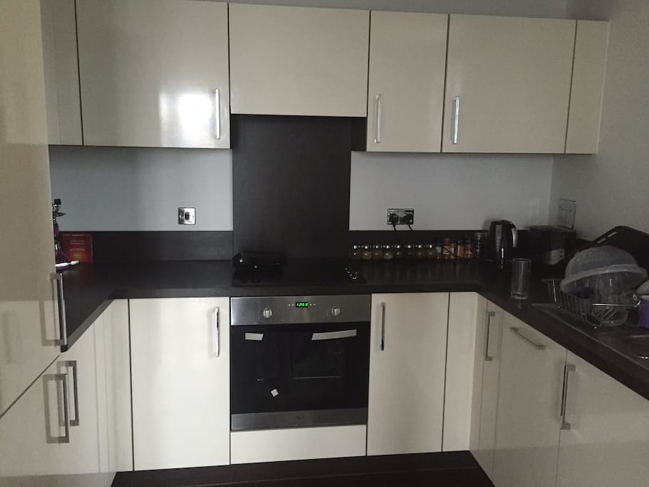 Full sized kitchen with oven, dishwasher, fridge, freezer and cooktop.