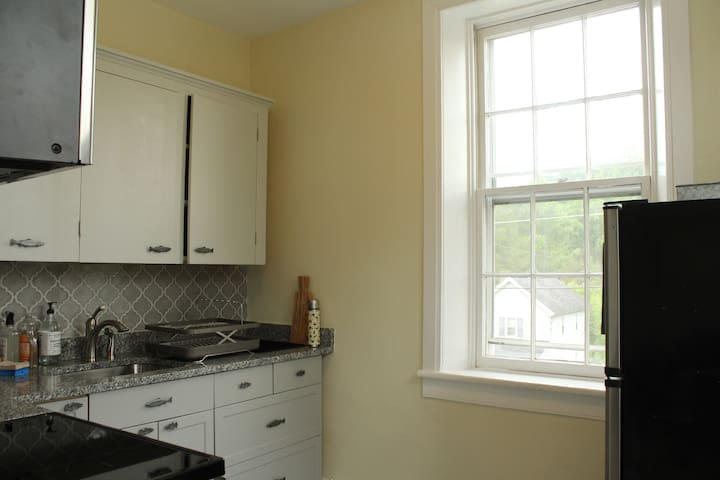 A fully equipped remodeled kitchen with brand new appliances.