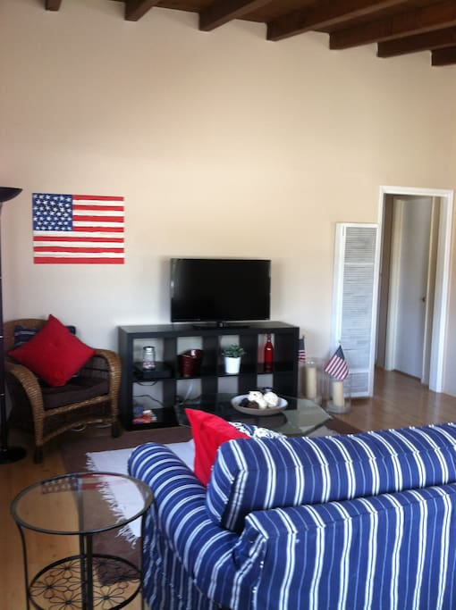 Living area, with red, white and blue county motif, exceptionally clean complete with Living area w/ gam40' Flat Screen TV, DVD and box es, wireless internet