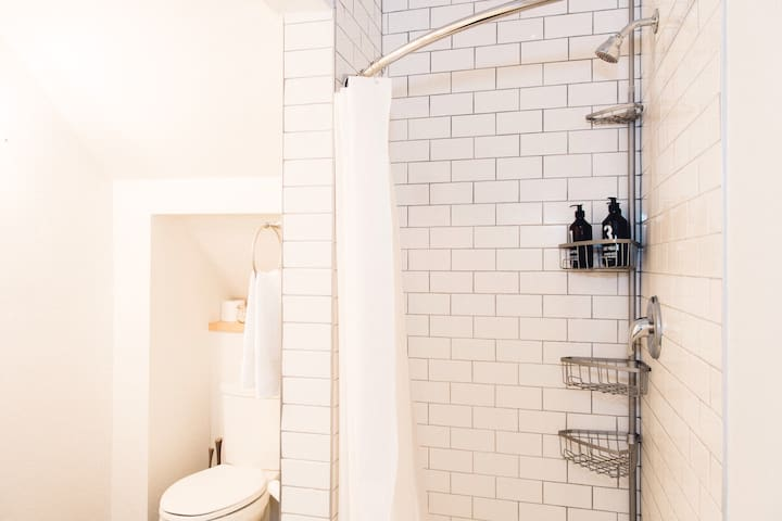 The private  bathroom is kept simple and clean.
