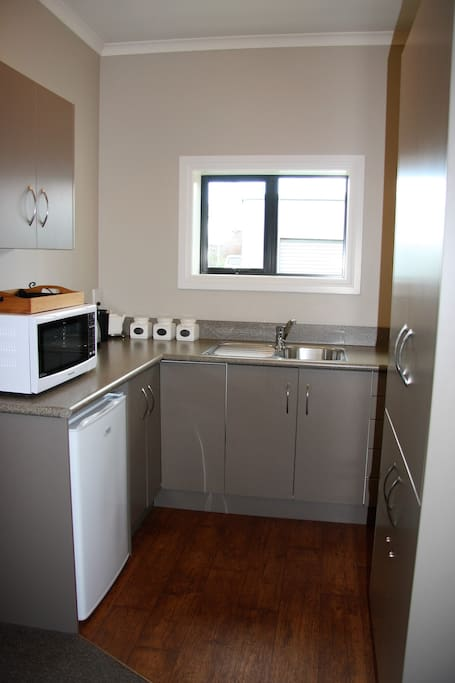 The well appointed kitchenette is very suited to all cooking requirements.