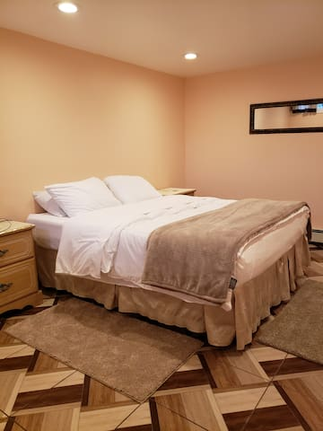 Bedroom includes a queen size bed