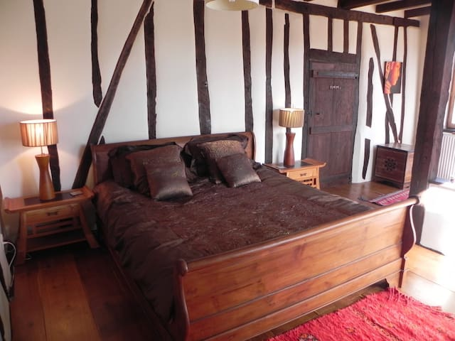 Second Bedroom with library, overlooks the courtyard