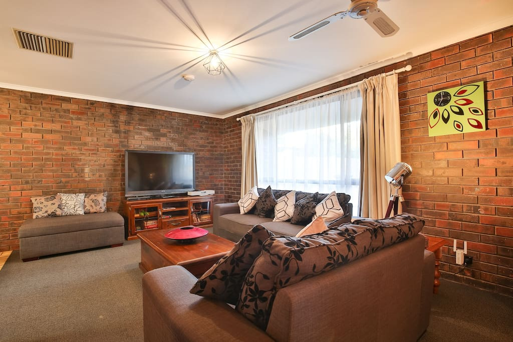 Spacious Lounge with large TV
