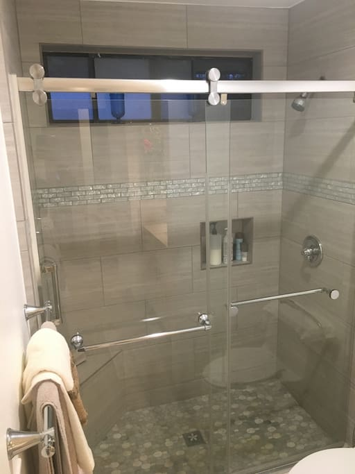 Who likes a shower with some SERIOUS water pressure? You do? Great. We got you covered. Also, I couldn't take a picture of the toilet, but it's next to the shower, to the right. Oh and there's a bidet attached to the toilet. So you can start your day off right.