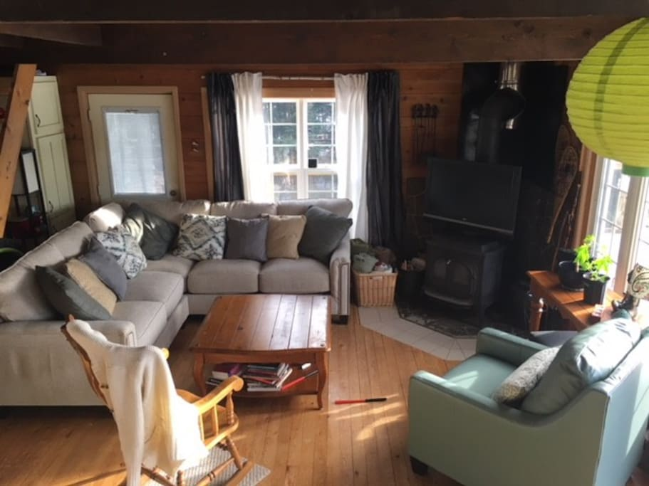 Open and bright living room with wood stove