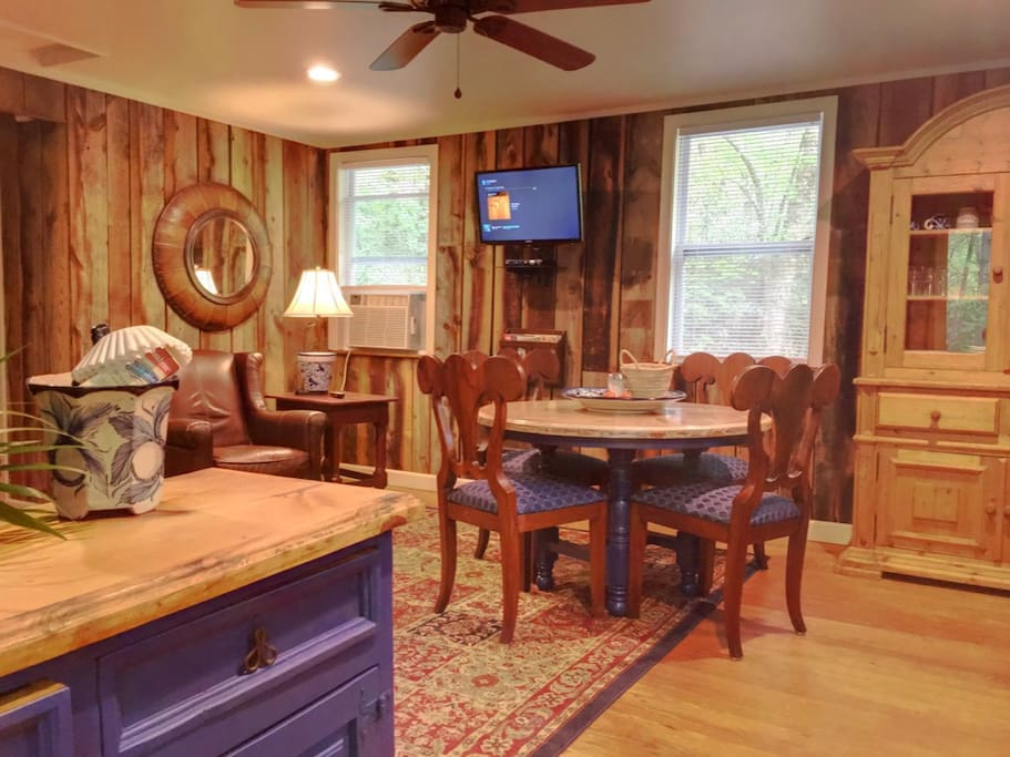 Open concept living, dining, kitchen. Grilling porch with gas grill is just outside kitchen.