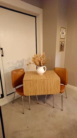 A kitchen dinette with chairs. The table if you lift up the side and slide out legs you can have large table.