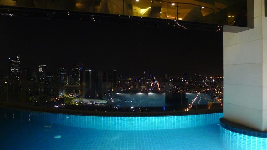 Infinity pool overlooking the Makati skyline