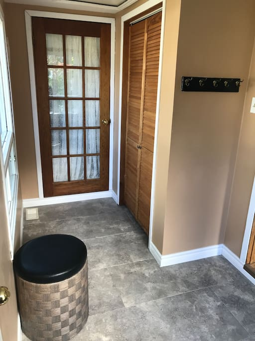 Spacious bright entryway with lots of room for luggage arrangements, many coats and oodles of shoes.   Two doors to choose from, one leading to the kitchen area and one leading to the living room space.
