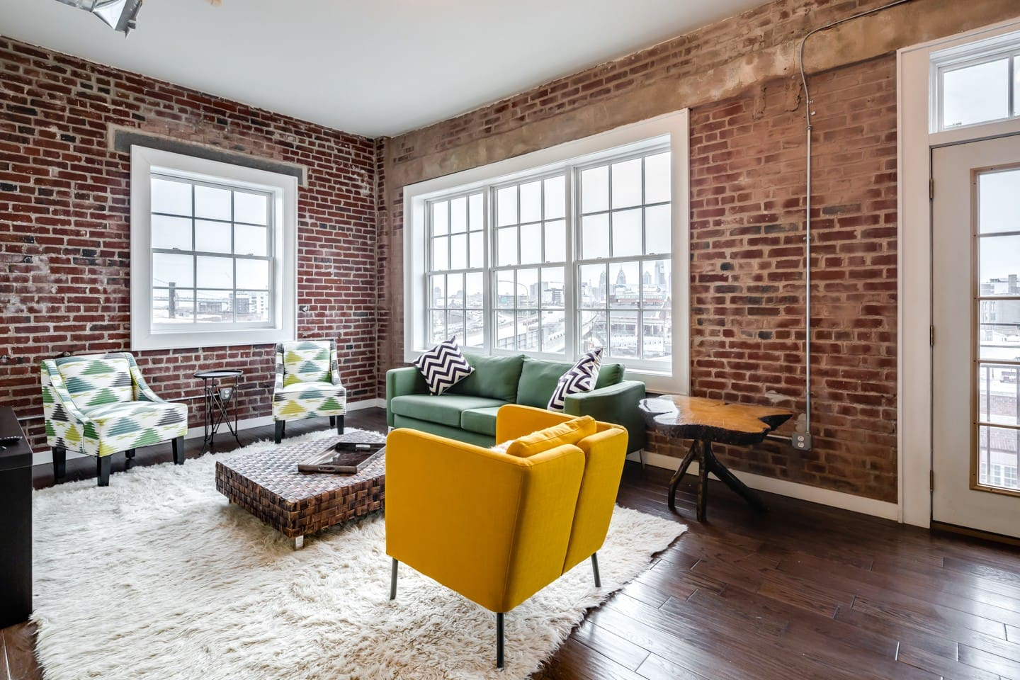 Gorgeous living room drenched in natural sunlight with amazing views of Center City Philadelphia