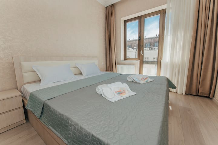 Bedroom 1 - double bed with balcony and view on Aghmashenebeli Avenue