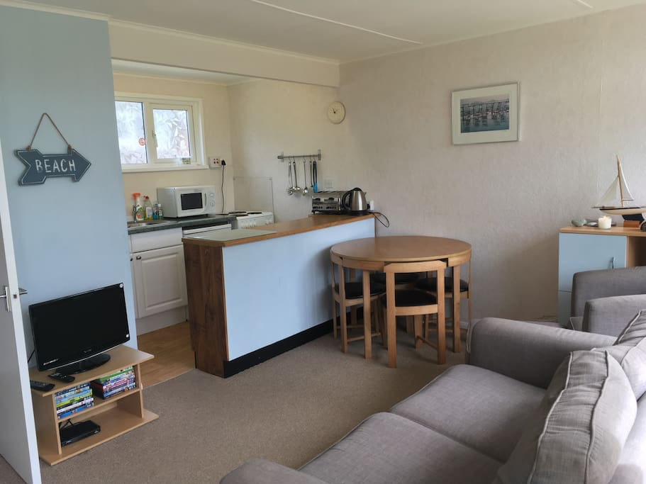 Open plan kitchen and living area; with sofa bed and freesat tv.
