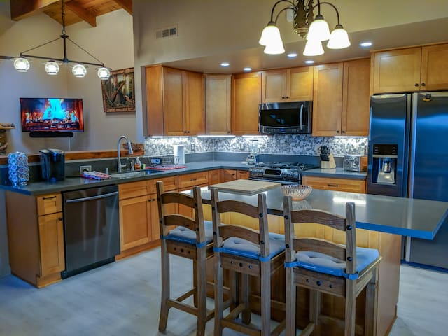Kitchen with brand new appliances and fully stocked for your vacation cooking needs.
