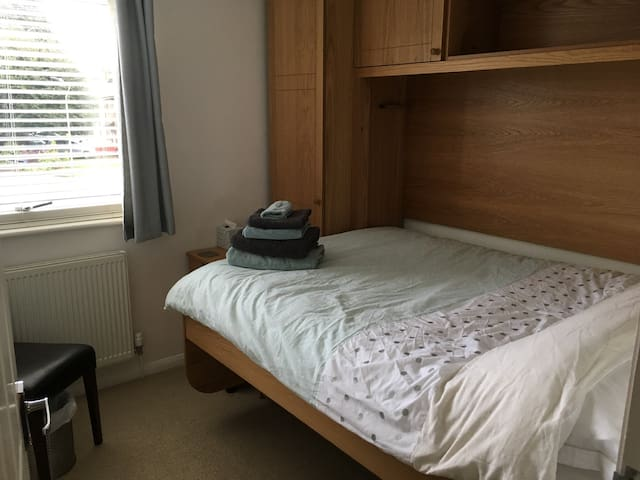 Full size double bed and guests tell me it's a really super comfy mattress.  Nice views of mature trees and the Cotswold hills beyond.  Plenty of hanging and drawer space for short stays and a 6' wide work station for those who need it.