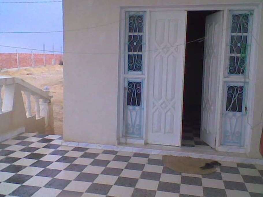 This is the entrance ,there is a large veranda in front of the door )
