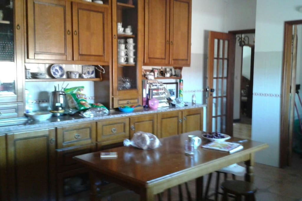Half of the kitchen.  This is a large kitchen, can accommodate 8 people easily siting at the table.