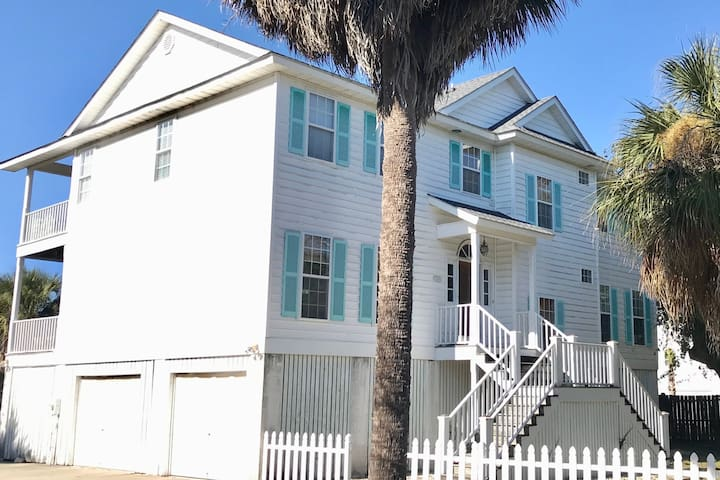 Steps from the beach with wraparound porches!