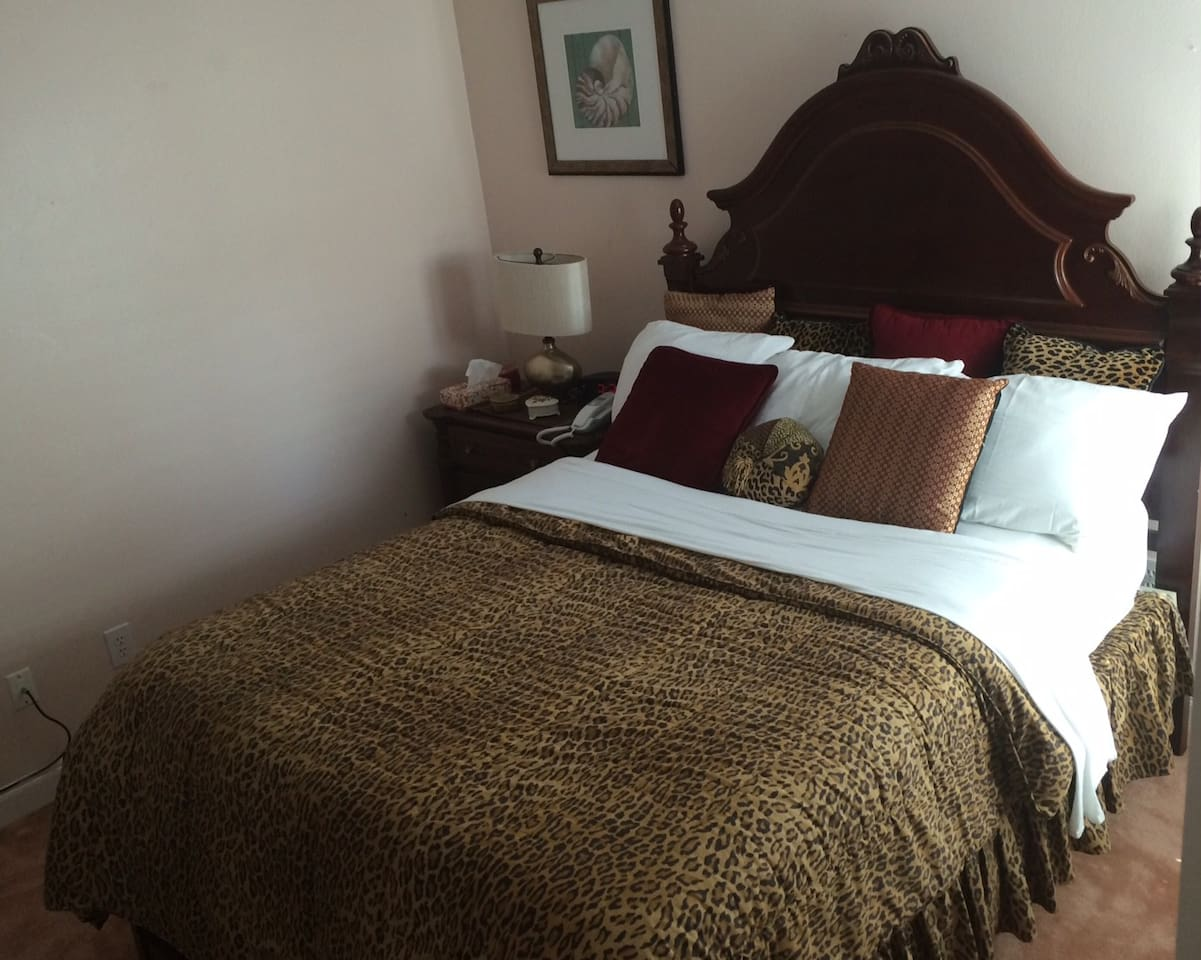 Queen bed with pillow-top mattress and traditional, solid cherry wood furnishings. Fresh clean linens, pillows, and comforters are provided by the host.
