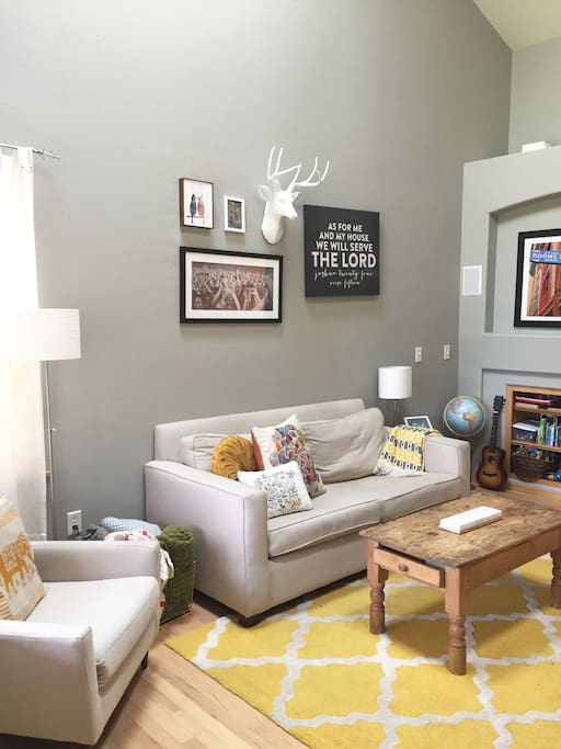 High, vaulted ceilings and grey tones make our living area spacious and calming.