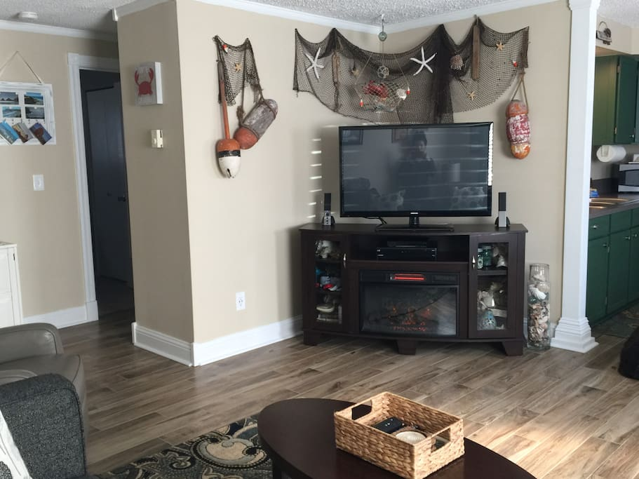 46 inch television, Dish Network, Blue-Ray (we have lots of movies and Netflix) and speakers with an auxiliary cord to listen to your music.  Yes, that's an electric fireplace-with a remote! Cozy!