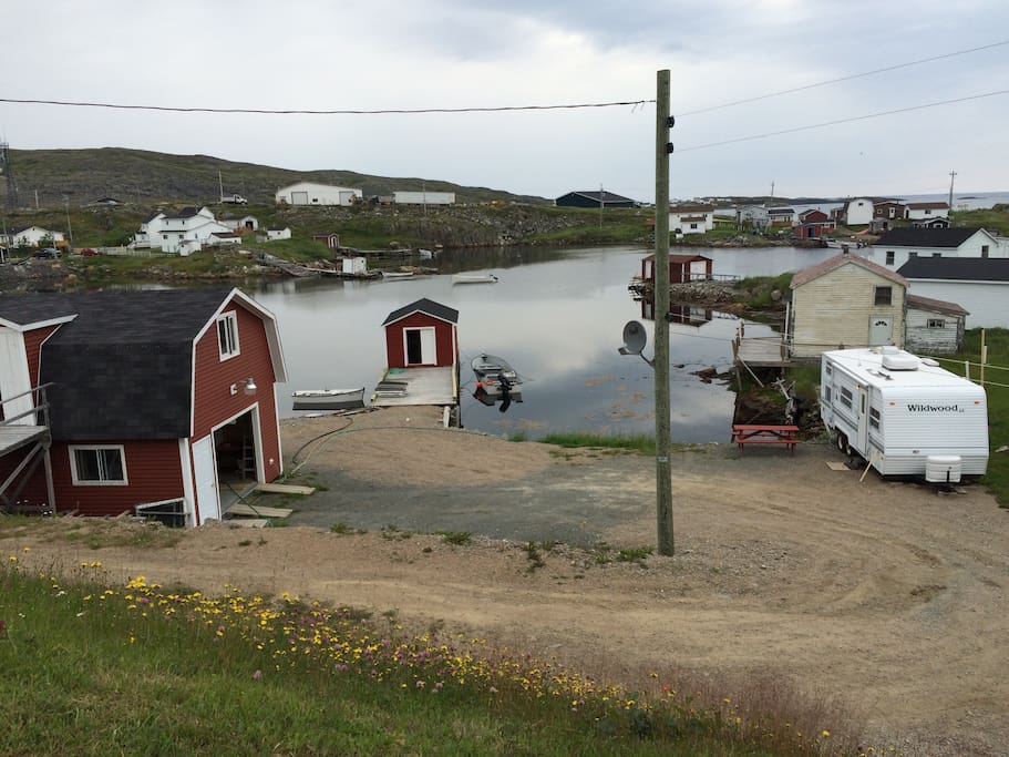 Ocean side with wharf and fishing stage.