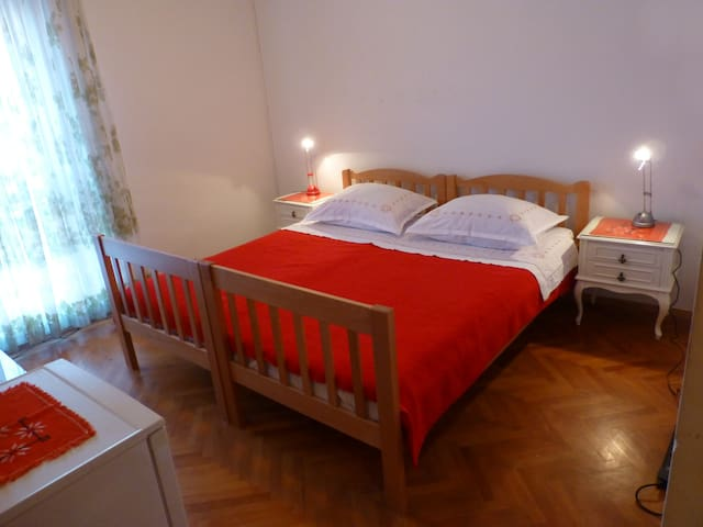 Double bed with shared bathroom and parking