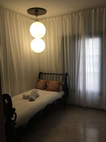 Single room, closet, window, and desk, or writing with lamp
