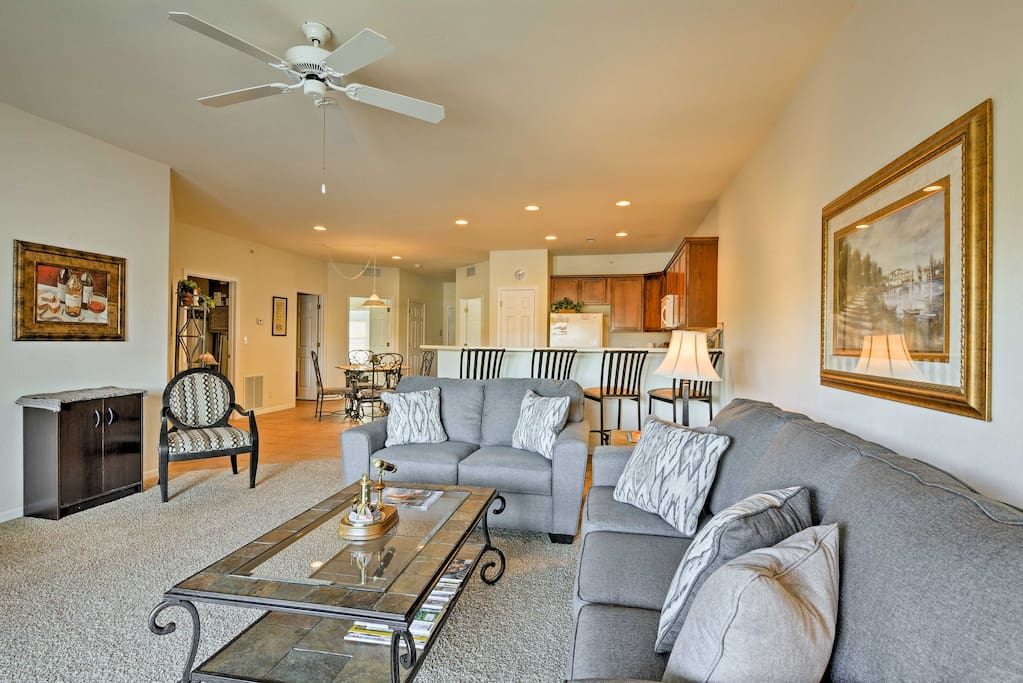 The living area includes vibrant furnishings and a flat-screen Smart TV.