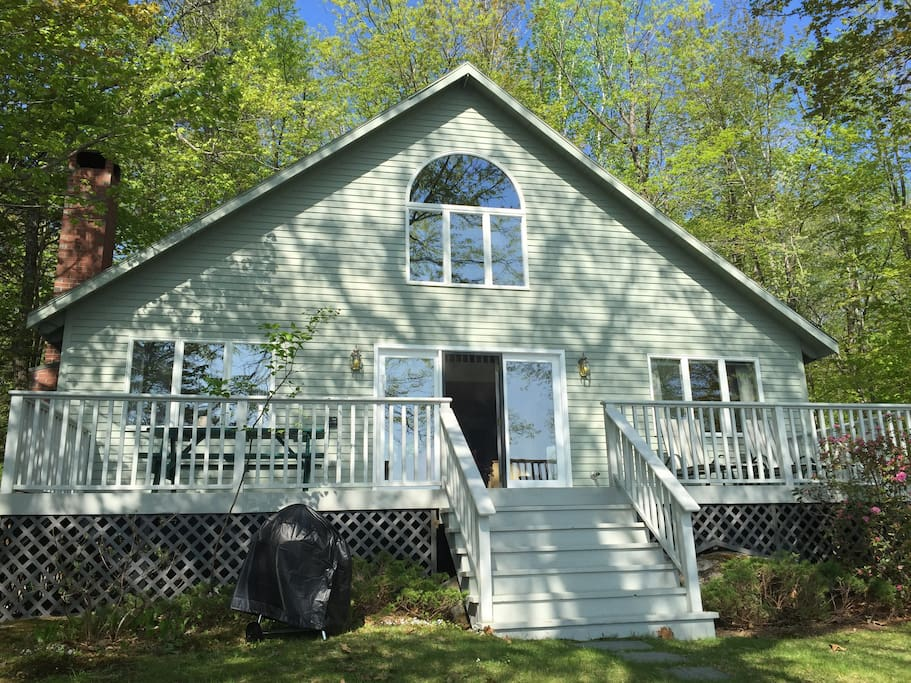 The house looks over Moose Pond with views from less than 50 ft off the water.