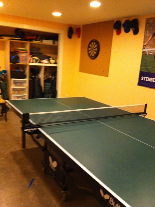 Play table tennis and darts in the shared rec room.