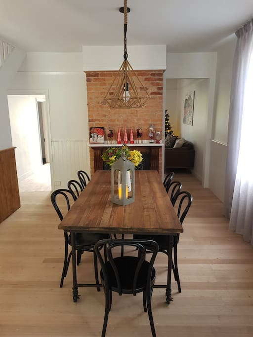 Dining Room with gas log fire.  Seating for eight at the table.