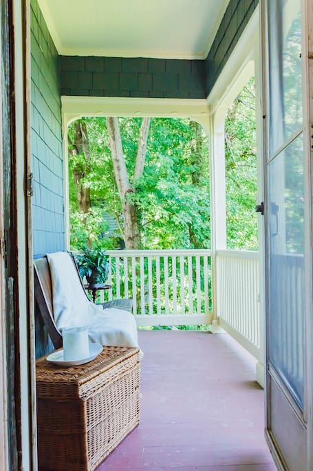 The private porch overlooking the backyard gardens