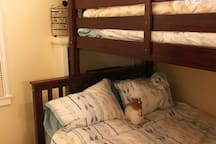Bedroom 2: double lower bunk, twin upper bunk, double trundle with clean bedding
