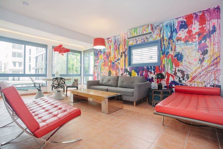 Spacious Living room inspired by American painter Sam Francis....with panoramic windows , air condition and ceiling fan