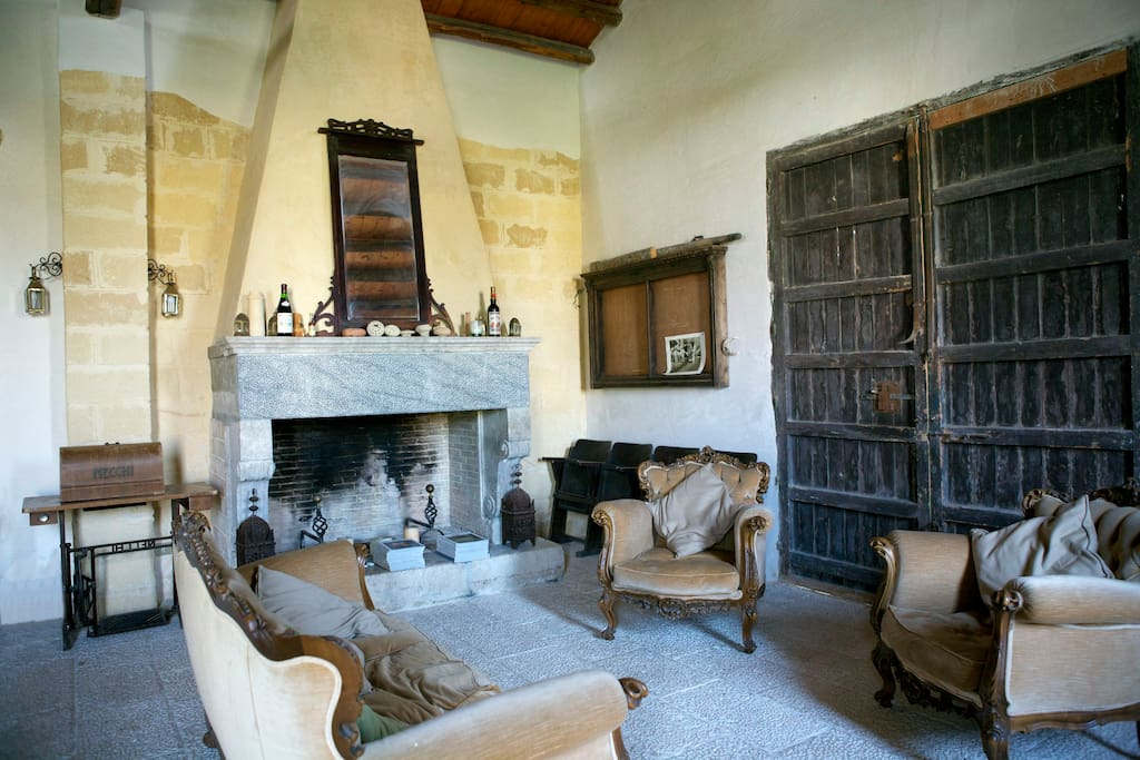 large living area with handmade carved marble floor, and boasts an impressive stone fireplace