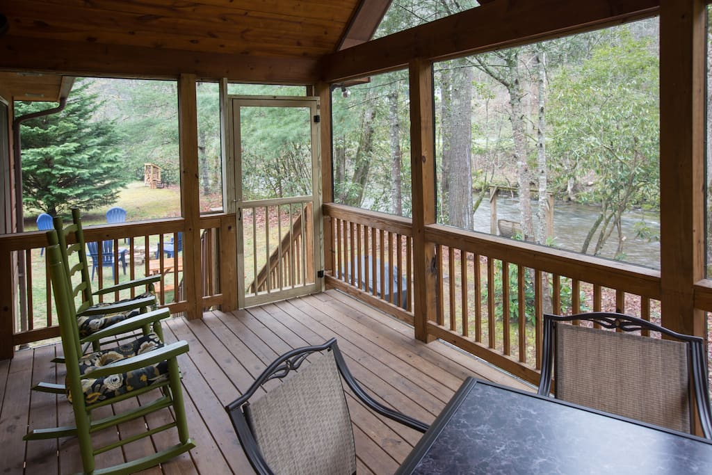 Relax and unwind by Snowbird Creek on the screened porch