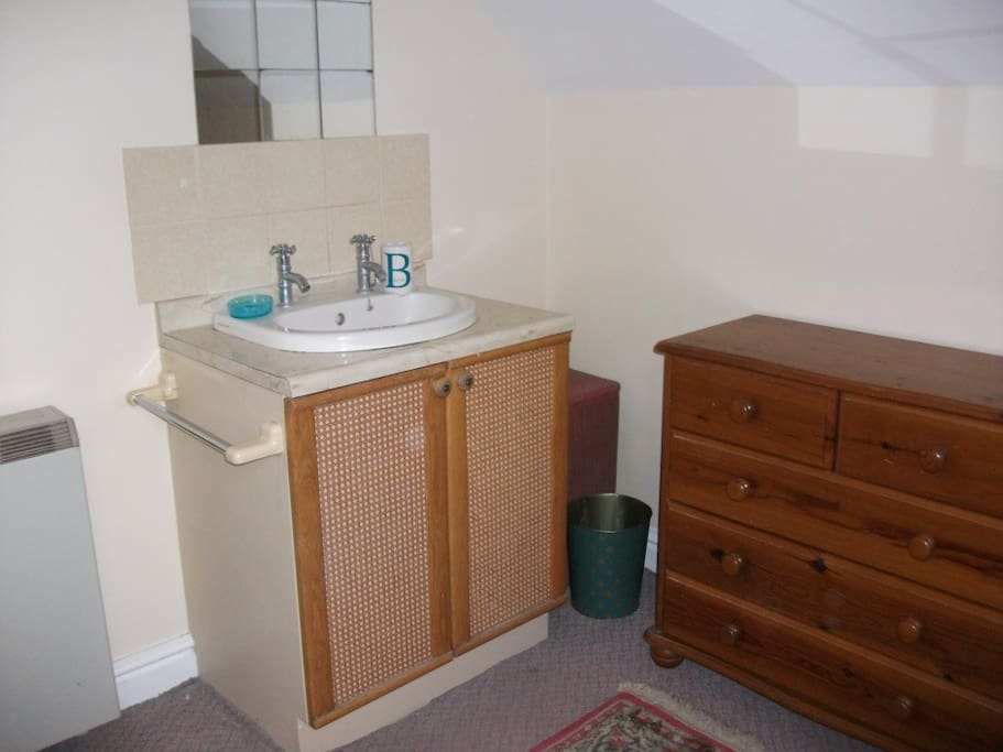 Washbasin in double bedroom