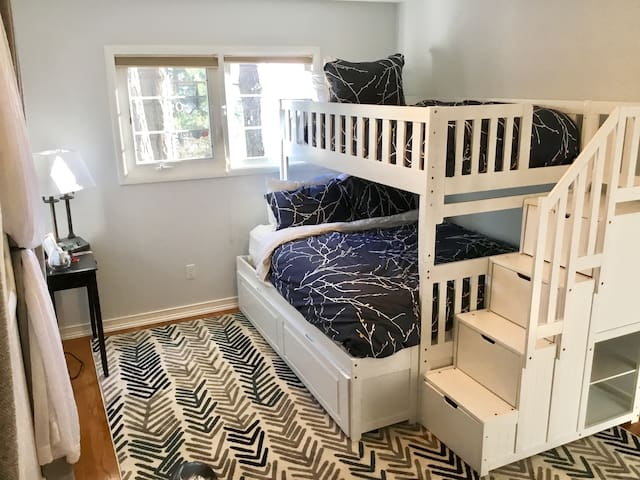 North bedroom with single upper bunk, twin bunk below, and if extra bed is needed, trundle bed pulls out for 3 separate beds