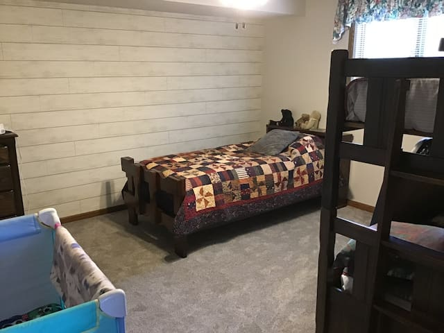 Bunk room with two beds. Recently repainted with new carpet and bedding.