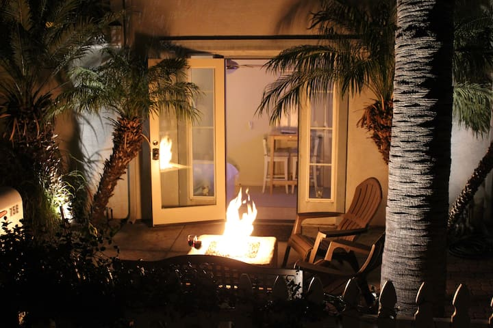 Private room opens to your own patio with gas fire pit just off York Court walkway.