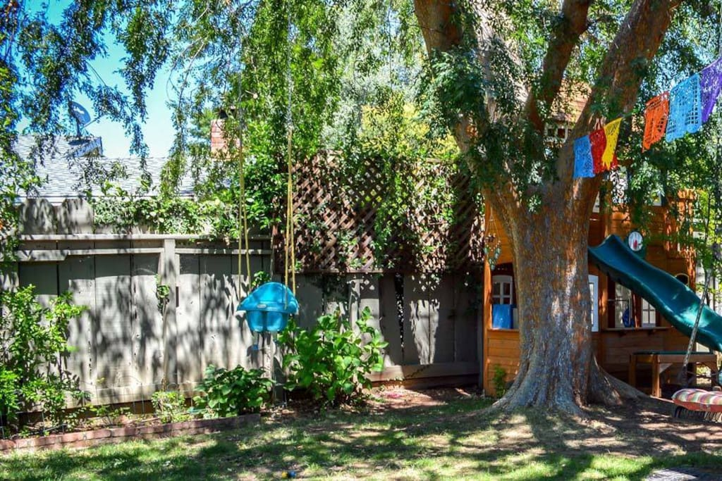 We love this big shady tree and our children have a blast in the playhouse.