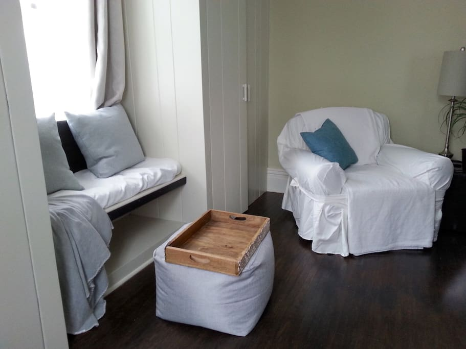Reading chair, ottoman and window seat.