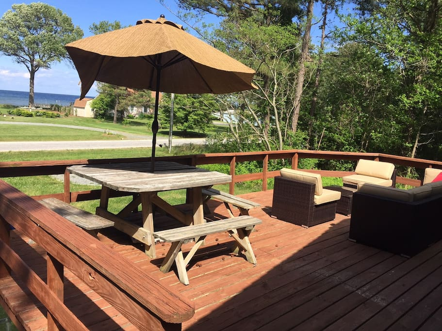 Deck with lounge seating & picnic table for enjoying the water view