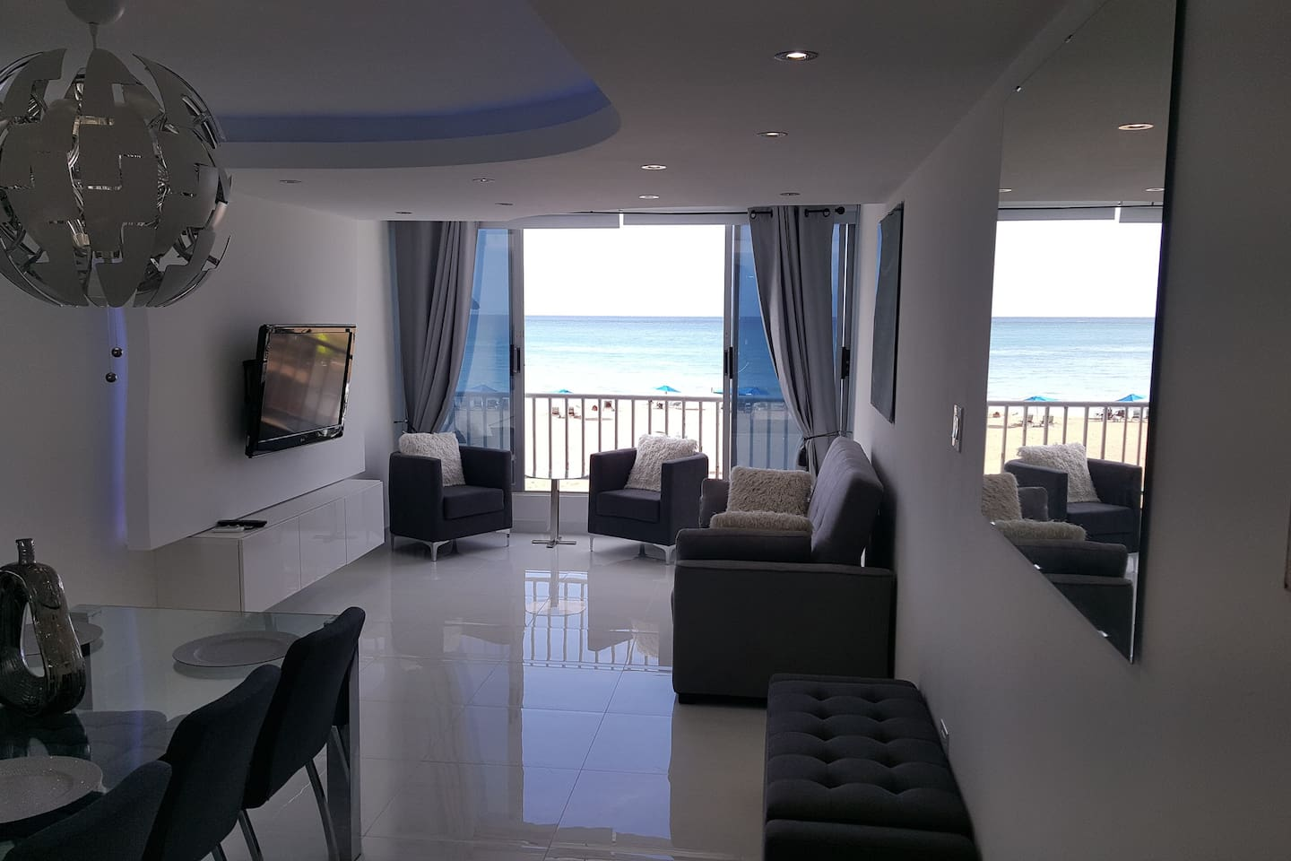 Completely Renovated! Ocean Front Living room, Entertainment  and dining area  !!! Milly 787-460-1794