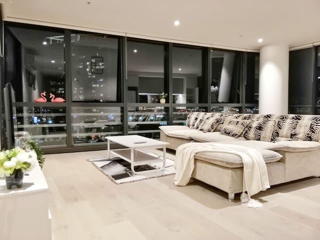 Spacious living room with luxurious sofa