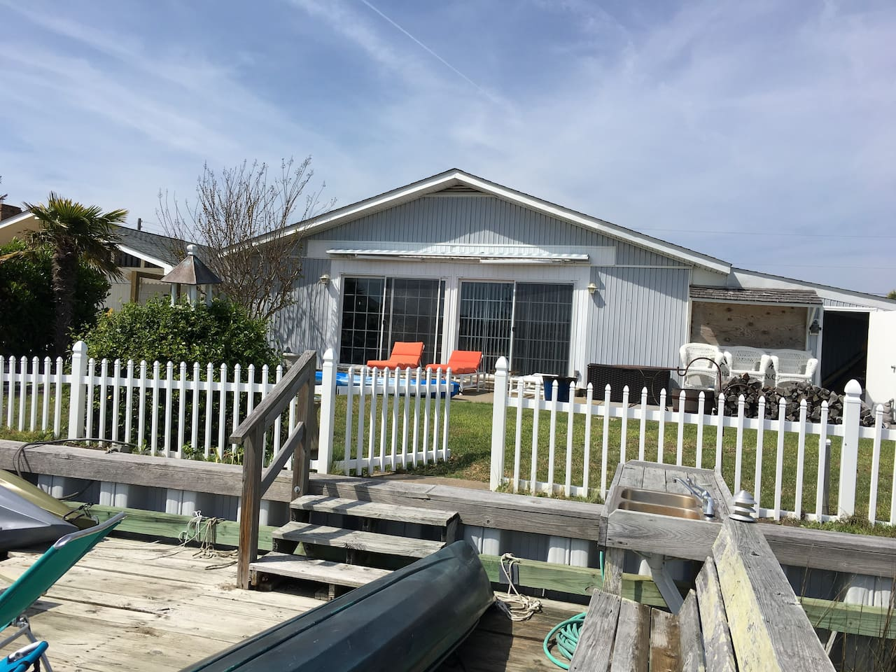 View from the dock. Bring your boat to this quiet neighborhood and find true relaxation. Great location is walking distance to the beach and very close to most anything else  that you will need for a great vacation.