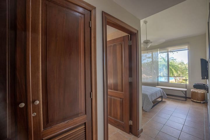 The third bedroom comes with a double bed and private ensuite bathroom