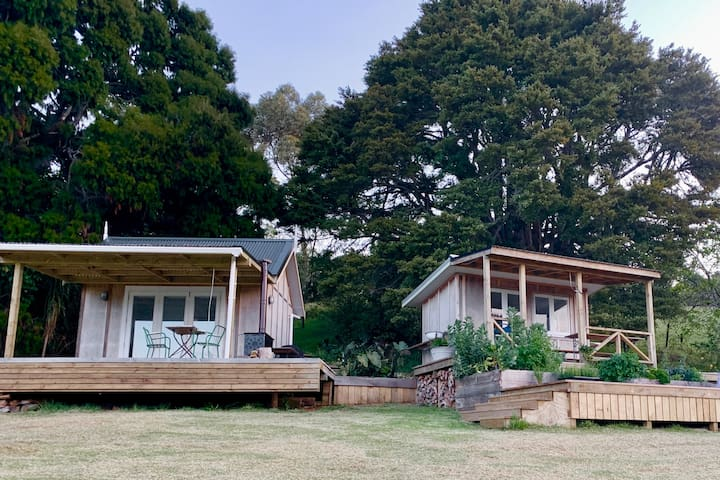 Around the corner are 3 cabins joined via a series of well-lit connecting decks and paths. On the left is the bedroom, kitchen on the right, and the bathroom cabin sits behind, up a pathway of steps. A sensor light ensures safety at night.
