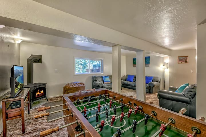 The kids of the group (or young at heart) will love this den with HDTV and foosball table